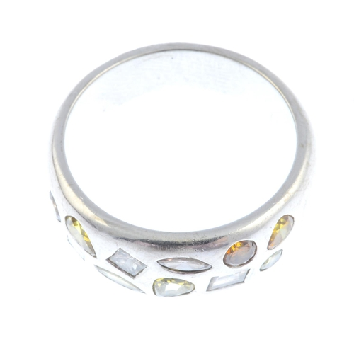 10 - A coloured diamond ring. Designed as a series of vari-shape and vari-hue diamonds, scattered to the ...