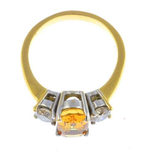 12 - An 18ct gold sapphire and diamond three-stone ring. The cushion-shape yellow sapphire, with brillian...