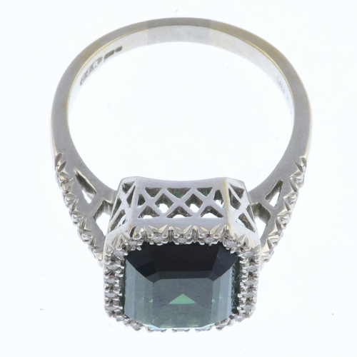 13 - FAVERO - an 18ct gold tourmaline and diamond ring. The rectangular-shape green tourmaline, with bril...