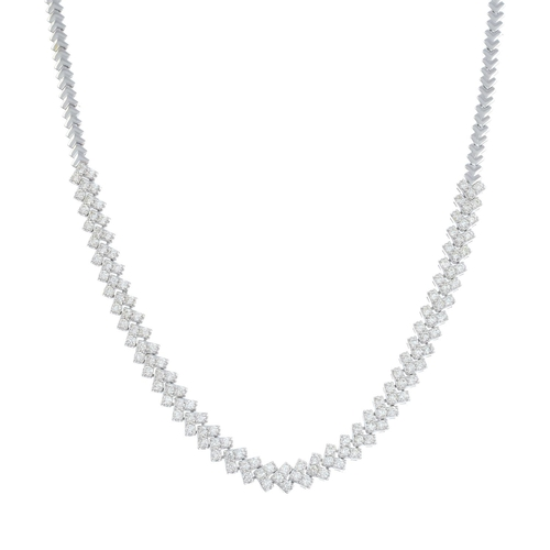 14 - A diamond necklace. Designed as a series of brilliant-cut diamond chevron links, suspended from a si...