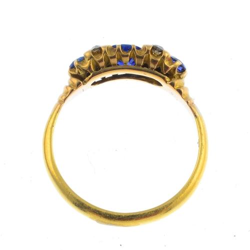 15 - An early 20th century 18ct gold sapphire and diamond ring. The oval-shape sapphire, with circular-sh...