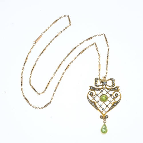 16 - An early 20th century 9ct gold peridot and split pearl pendant. Designed as a split pearl openwork l...