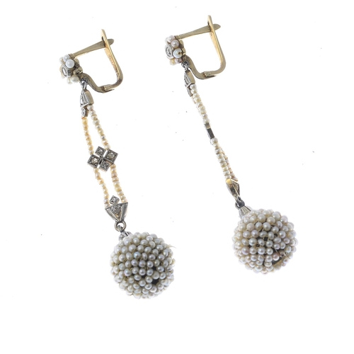 17 - A pair of early 20th century seed pearl and diamond earrings. Each designed as a seed pearl sphere a...