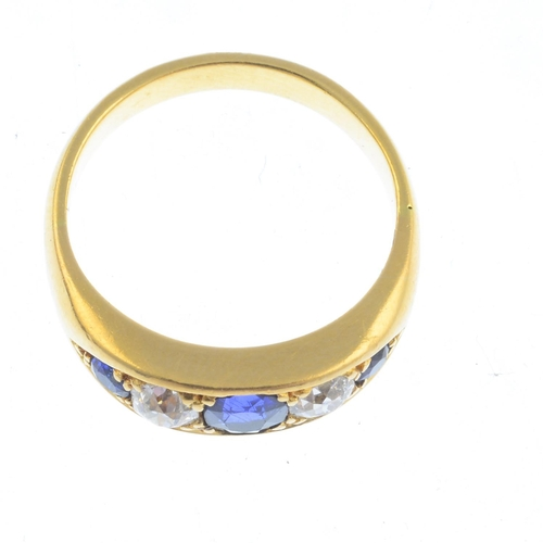 18 - An early 20th century 18ct gold sapphire and diamond five-stone ring. The designed as an alternating...