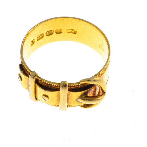 19 - A late Victorian 18ct gold ring. Designed as a buckle, with screw head accents and grooved sides. Ha...