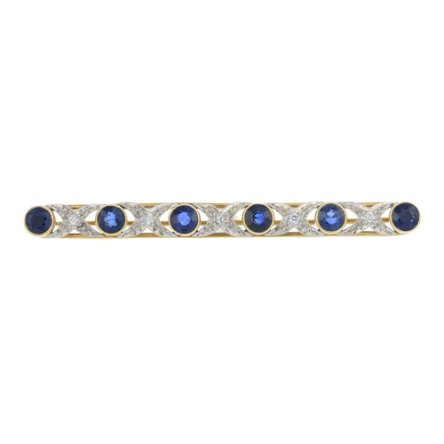 21 - A sapphire and diamond bar brooch. The circular sapphire collet line, with old-cut diamond cross spa...