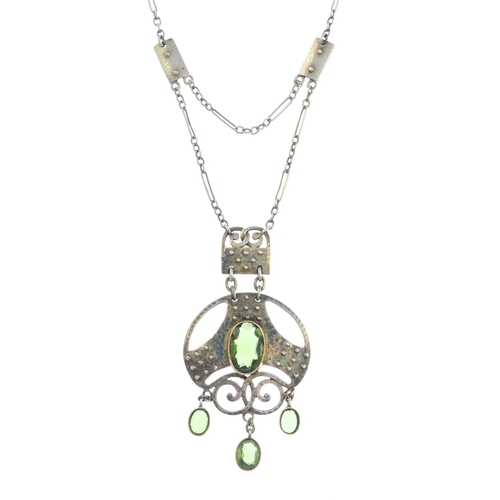 24 - MURRLE BENNETT & CO. - an early 20th century silver paste necklace. The oval-shape green paste fring...