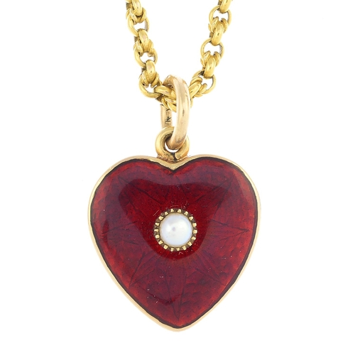 26 - An early 20th century gold enamel and split pearl pendant. The star motif red guilloche enamel heart...