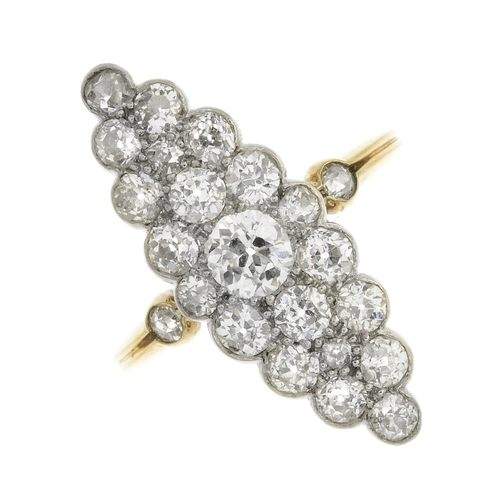 27 - A diamond cluster ring. Of marquise-shape outline, the old-cut diamond, with similarly-cut diamond s...