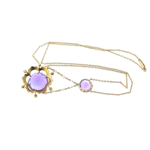 28 - An early 20th century 15ct gold amethyst and seed pearl necklace. The circular-shape amethyst and se...