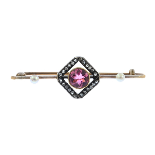 31 - An Edwardian gold and silver, diamond and gem-set brooch. The circular-shape pink tourmaline, with r...