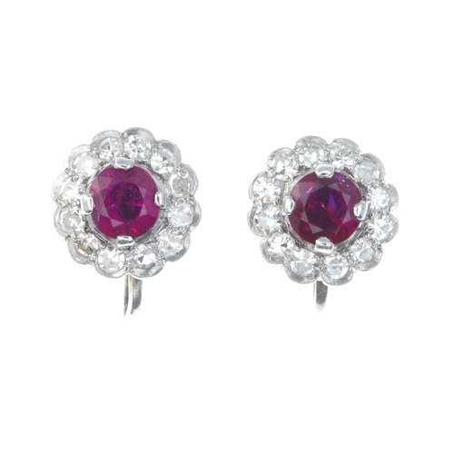 32 - A pair of early 20th century 9ct gold ruby and diamond floral cluster earrings. Each designed as a c...