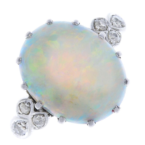 33 - An early 20th century 18ct gold and platinum, opal and diamond ring. The oval opal cabochon, with ci...