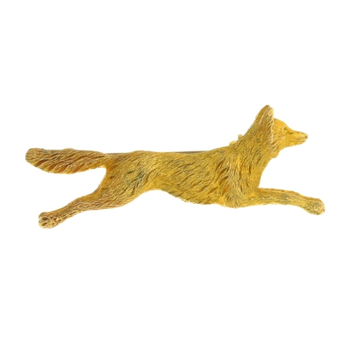 34 - An early 20th century 9ct gold brooch. Designed as a textured, running fox. Length 4.3cms. Weight 9....