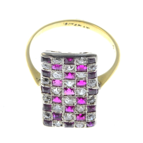 35 - An early 20th century 18ct gold and platinum, synthetic ruby and diamond ring. Designed as a square-...