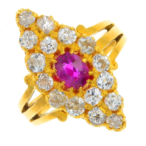 37 - A ruby and diamond cluster ring. Of marquise-shape outline, the oval-shape ruby, with old-cut diamon...