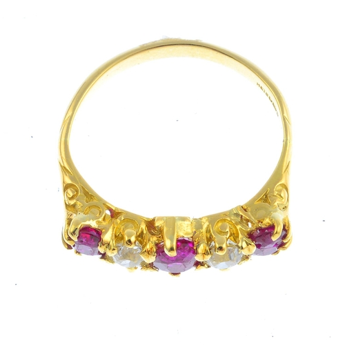 39 - An 18ct gold ruby and diamond five-stone ring. The alternating graduated oval-shape ruby and old-cut...