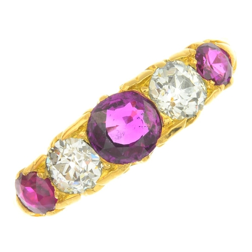 40 - An early 20th century 18ct gold ruby and diamond five-stone ring. The alternating graduated circular...