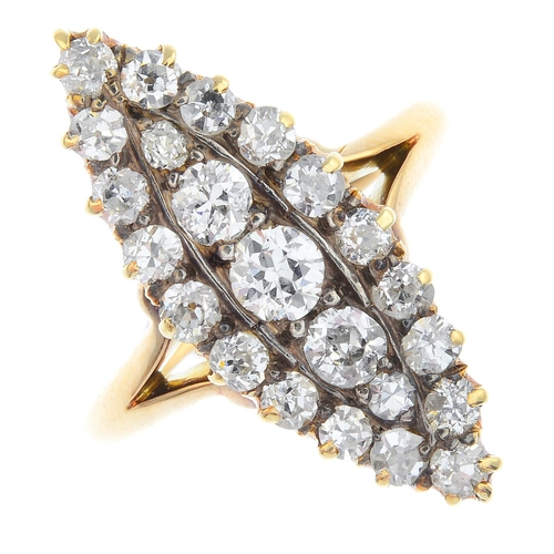 41 - An early 20th century gold diamond cluster ring. Of marquise-shape outline, the graduated old-cut di...