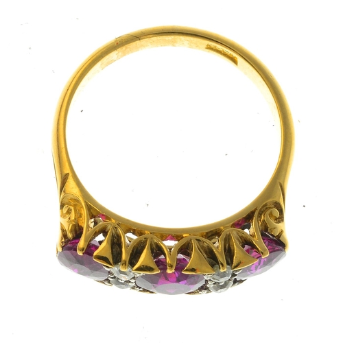 44 - An early 20th century 18ct gold Thai ruby three-stone and diamond ring. The graduated cushion-shape ...