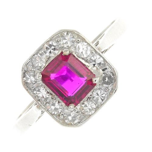 46 - A ruby and diamond cluster ring. The rectangular-shape ruby, with single-cut diamond surround. Ruby ...