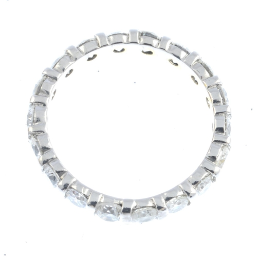 48 - A diamond full eternity ring. The brilliant-cut diamond line, with bar spacers. Estimated total diam...