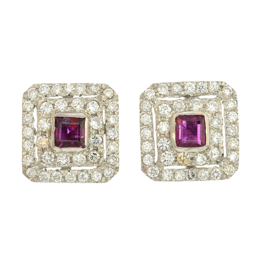 49 - A pair of ruby and diamond cluster earrings. Each designed as a square-shape ruby, with brilliant-cu...