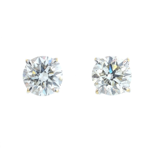 51 - A pair of brilliant-cut diamond stud earrings. Estimated total diamond weight 1.25cts, I-J colour, S...