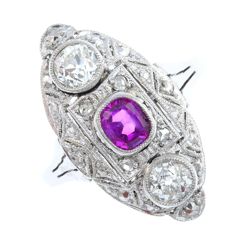 52 - An 18ct gold ruby and diamond ring. The alternating cushion-shape ruby and old-cut diamond line, wit...