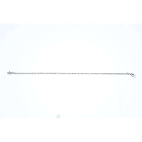 53 - A diamond bracelet. Designed as a brilliant-cut diamond line, with partially concealed push-piece cl...