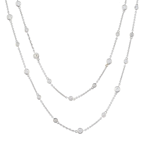 54 - A diamond necklace. Designed as a series of brilliant-cut diamond collets, alternating in size, spac...