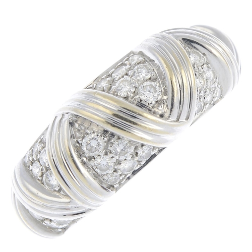58 - BOUCHERON - an 18ct gold diamond ring. The pave-set diamond panel, with grooved chevron spacers. Sig...