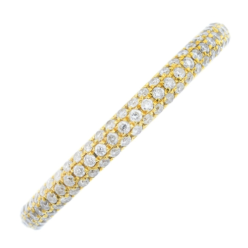 6 - An 18ct gold diamond full eternity ring. Designed as a pave-set diamond band. Estimated total diamon...
