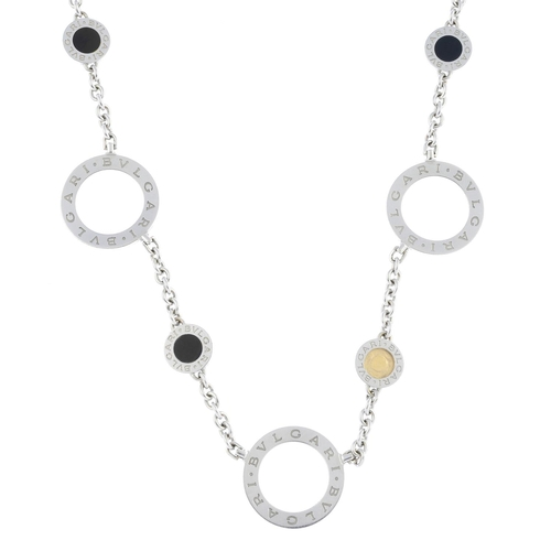 60 - BULGARI - an 18ct gold 'Bulgari' onyx necklace. Designed as a series of curved open discs, with circ...