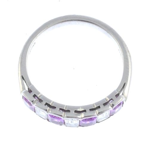 8 - An 18ct gold sapphire and diamond half eternity ring. Designed as an alternating rectangular-shape d...