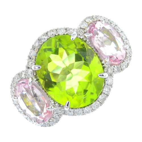 9 - A diamond and gem-set dress ring. The oval-shape peridot, with oval-shape morganite sides and brilli...