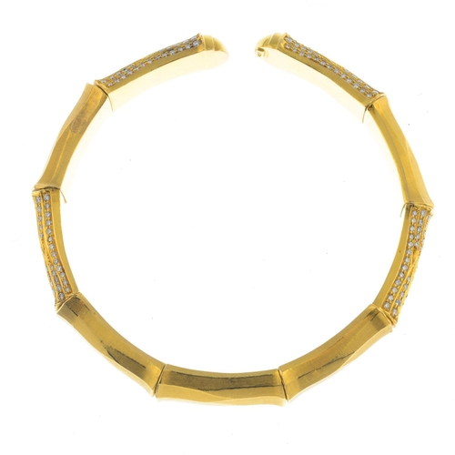 12 - A diamond flexible bangle. The stylised bamboo open cuff, with alternating polished and pave-set dia...