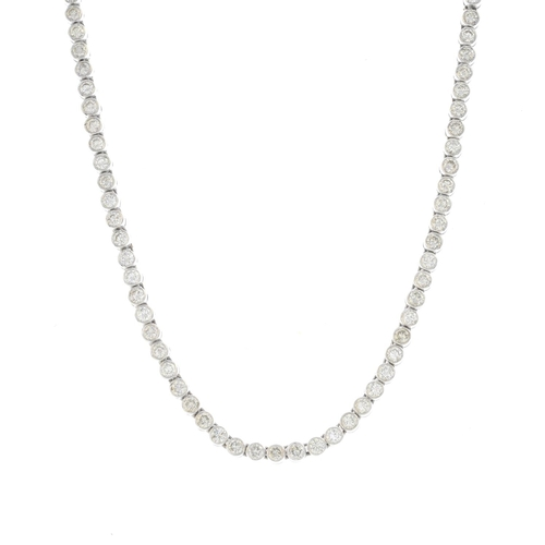 13 - An 18ct gold diamond necklace. Designed as a brilliant-cut diamond collet line. With report WGI96241...
