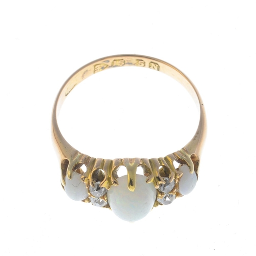15 - A late Victorian 15ct gold opal three-stone and diamond ring. The graduated oval opal cabochon line,...