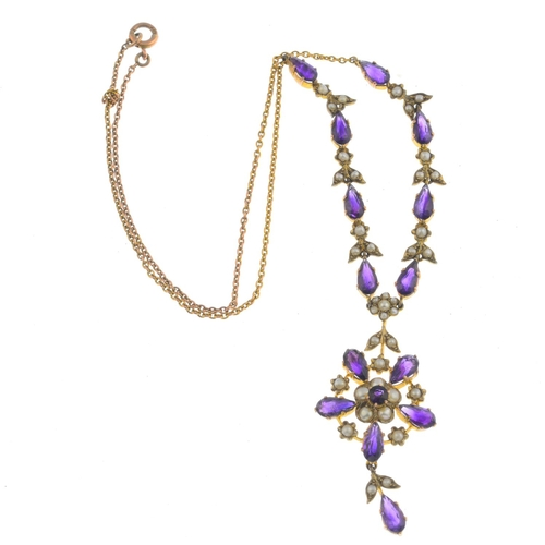 16 - An Edwardian gold amethyst and split pearl necklace. The vari-shape amethyst and split pearl floral ...