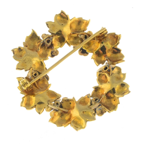 20 - An early 20th century 18ct gold enamel and gem-set brooch. Designed as a green and yellow enamel ivy...