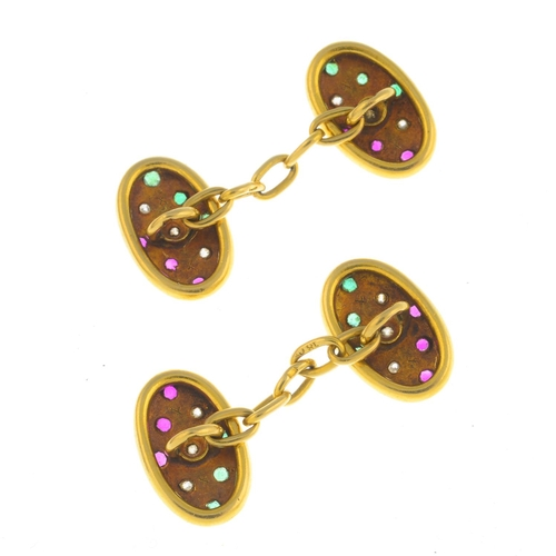 21 - A pair of early 20th century 18ct gold gem-set cufflinks. Each designed as an oval-shape panel, inse...