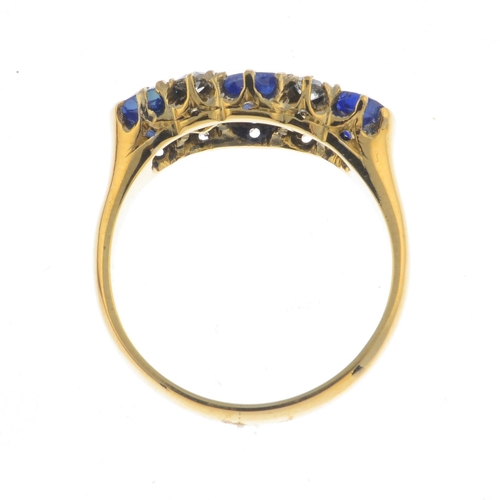 36 - An early 20th century 18ct gold sapphire three-stone and diamond ring. Designed as a graduated cushi...