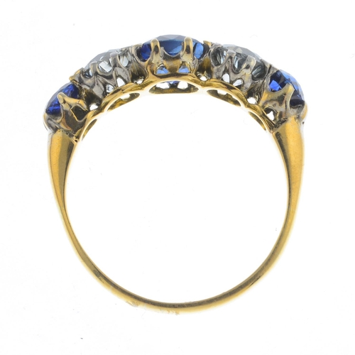 38 - A sapphire and diamond five-stone ring. The alternating circular-shape shape sapphire and old-cut di...