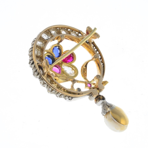 40 - A diamond and gem-set brooch. The vari-cut diamond, ruby, sapphire and cultured pearl flower, within...