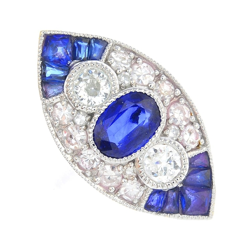 46 - A sapphire and diamond dress ring. Of marquise-shape outline, the oval-shape sapphire and brilliant-...