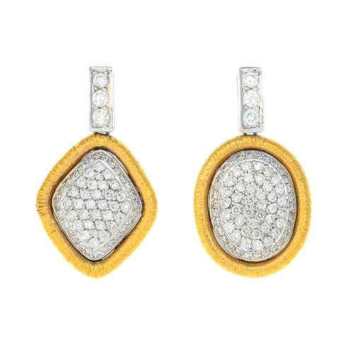 5 - A pair of diamond earrings. Each designed as a bi-colour oval or kite-shape pave-set diamond panel, ...