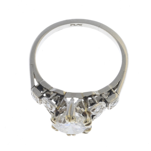 52 - A mid 20th century platinum diamond single-stone ring. The brilliant-cut diamond, with single-cut di...