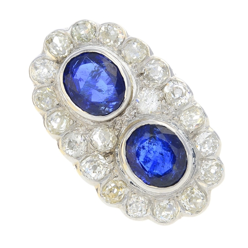 53 - An 18ct gold Burmese sapphire and diamond double cluster ring. The oval-shape sapphire collets, with...