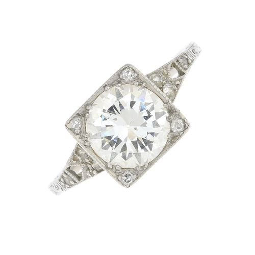 54 - An early 20th century diamond single-stone ring. Of square outline, the circular-cut diamond, with s...